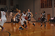 Lafayette High's Shelbi Buford (13) vs. New Albany in girls high school basketball action in Oxford, Miss., on Friday, January 10, 2014. Lafayette High won 47-38.