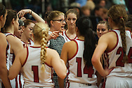 CVU head coach Ute Otley talks to the team during the girls basketball game between the Rice Green Knights and the Champlain Valley Union Redhawks at CVU High School on Monday night December 14, 2015 in Hinesburg. (BRIAN JENKINS/for the FREE PRESS)