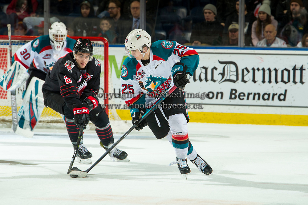 KELOWNA, CANADA - JANUARY 16:  Josh Brook #2 of the Moose Jaw Warriors stick checks Kyle Crosbie #25 of the Kelowna Rockets during first period on January 16, 2019 at Prospera Place in Kelowna, British Columbia, Canada.  (Photo by Marissa Baecker/Shoot the Breeze)
