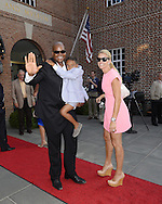 COOPERSTOWN, NY - JULY 26:  2014 Hall of Fame inductee Frank Thomas, wife Megan and son Frankie III pose for a photo during the annual Parade of Legends down Main Street in Cooperstown, New York on July 26, 2014.