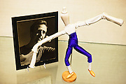 "A miniture with costume from Nikolais' 1963 dance ""Imago"", right, and an portait of  Alwin Nikolais."