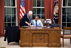 President Barack Obama confers with Gayle Smith, Senior Director for Development and Democracy, in the Oval Office, Oct. 21, 2014. (Official White House Photo by Pete Souza)<br /> <br /> This official White House photograph is being made available only for publication by news organizations and/or for personal use printing by the subject(s) of the photograph. The photograph may not be manipulated in any way and may not be used in commercial or political materials, advertisements, emails, products, promotions that in any way suggests approval or endorsement of the President, the First Family, or the White House.