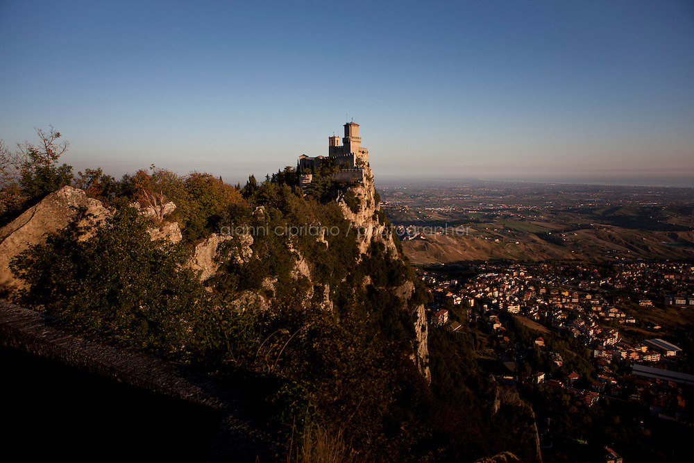SAN MARINO, SAN MARINO - 4 OCTOBER 2011:A view of the Second Tower at dawn on Mount Titano in the capital of San Marino, San Marino on October 4, 2011. The San Marino national football team is the last team in the FIFA  World Ranking (position 203). San Marino, whose population reaches 30,000 people, has never won a game since the team was founded in 1988. They have only ever won one game, beating Liechtenstein 1&ndash;0 in a friendly match on 28 April 2004. The Republic of San Marino, an enclave surronded by Italy situated on the eastern side of the Apennine Moutanins, is the oldest consitutional republic of the world<br /> <br /> <br /> ph. Gianni Cipriano