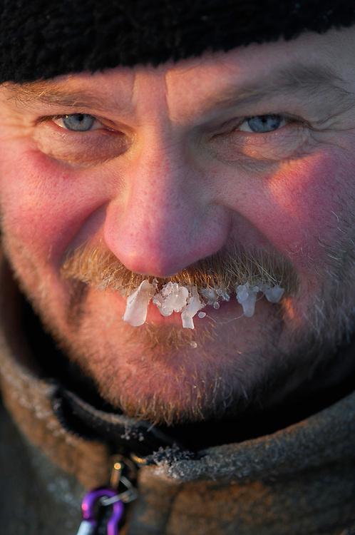 Ecotourist Paul Kolk, on midwinter reindeer sledding trip, Muddus National Park, Norrbotten,  Lapland; Sweden