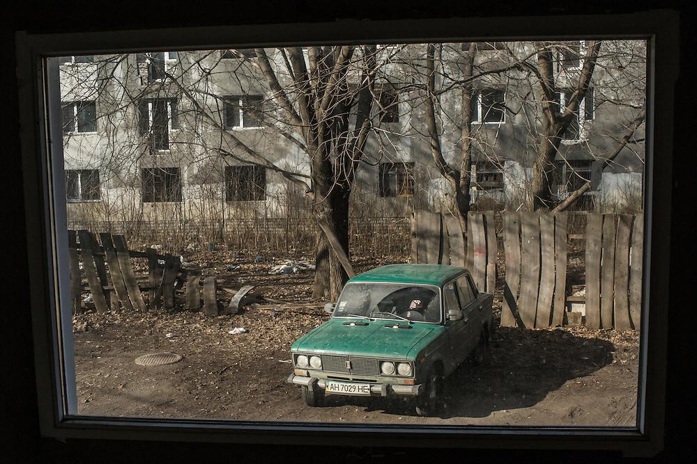 A greed Lada, seen through a window on Friday, February 12, 2016 in Slovyansk, Ukraine.