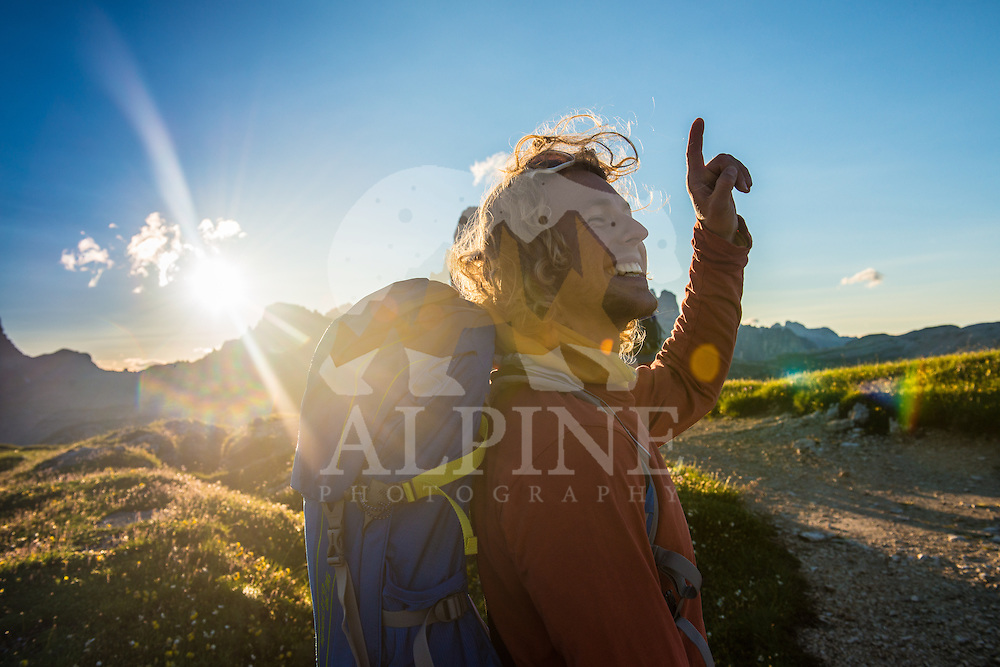 A male athlete as seen on a cold but sunny Summer morning, hiking on Monte Piana, South Tyrol, Italy.