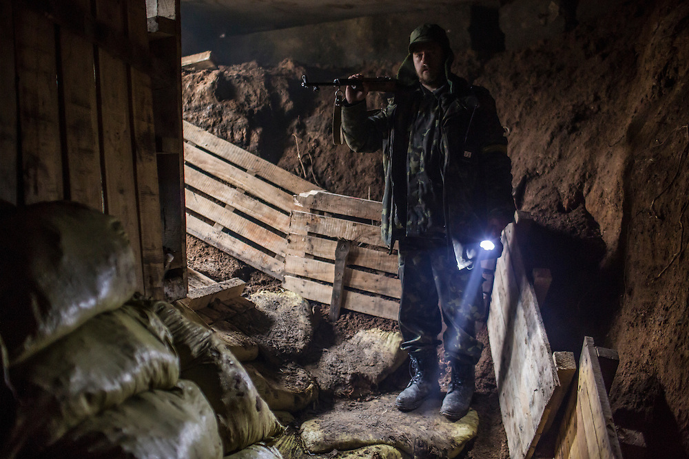 TALAKIVKA, UKRAINE - FEBRUARY 5, 2015: A member of the St. Mary's Battalion, a pro-Ukraine militia, inside a bunker at a front-line encampment in Talakivka, Ukraine. With more than 220 people having died in the past several weeks, a new diplomatic push is underway to bring an end to fighting between pro-Russia rebels and Ukrainian forces. CREDIT: Brendan Hoffman for The New York Times