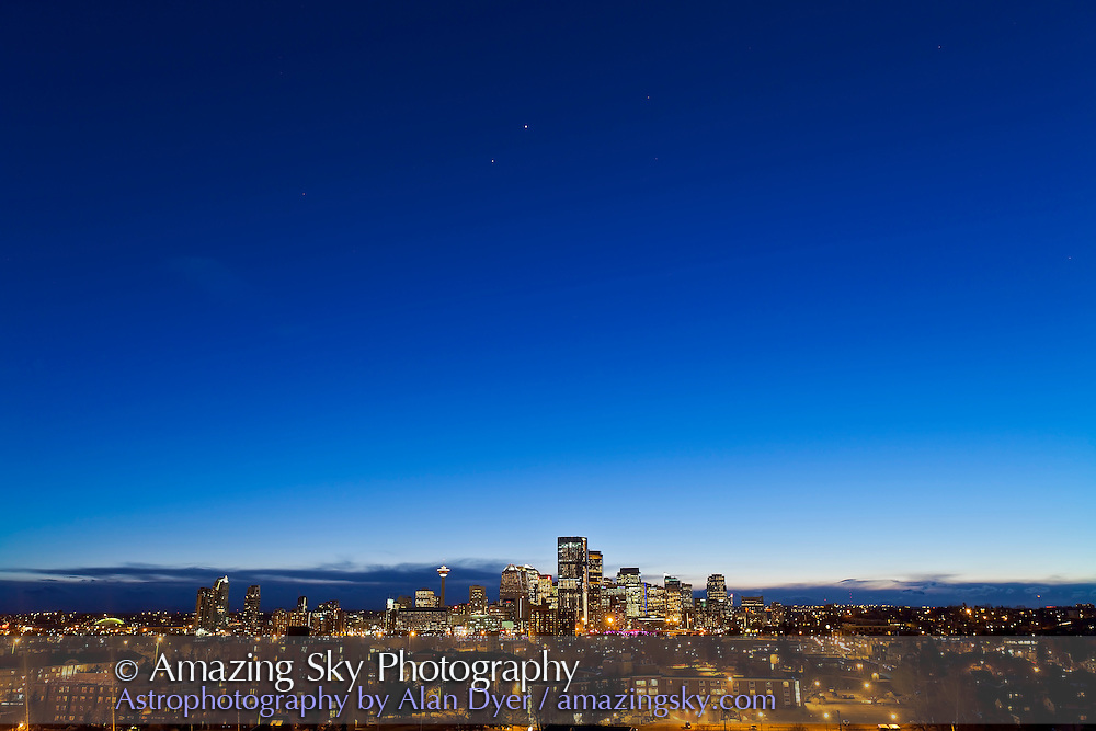 Venus and Jupiter over Calgary skyline, from Tom Campbell Hill, March 14, 2012. Taken with Canon 5D MkII and 16-35mm lens at 27mm for 2s at f/5.6 and ISO 200.