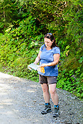 Female hiker examines a map. photographed in Zillertal, Tirol, Austria