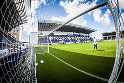 Falkirk FC keeper Michael McGovern in the goals during the pre-game warm-up. The Falkirk Stadium, with the new pitch work for the Scottish Championship game v Morton. The woven GreenFields MX synthetic turf and the surface has been specifically designed for football with 50mm tufts compared with the longer 65mm which has been used for mixed football and rugby uses.  It is fully FFA two star compliant and conforms to rules laid out by the SPL and SFL.<br />
