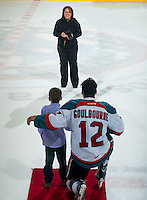 KELOWNA, CANADA - JANUARY 24: Cindy Rogers, a photographer with the Kelowna Rockets takes photos of the three stars on January 24, 2015 at Prospera Place in Kelowna, British Columbia, Canada.  (Photo by Marissa Baecker/Shoot the Breeze)  *** Local Caption *** Cindy Rogers;