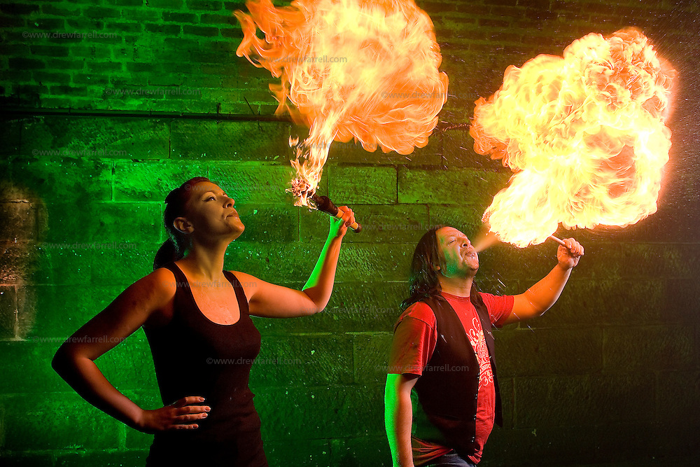 Picture shows :  Writer Ailsa Longmuir  (in black) learns the Art of Fire Breathing / Fire Eating with her first  lesson from the Purple Productions team of Rufus T. Fahrenheit and Lucille Burn (animal print)....Picture Drew Farrell Tel : 07721-735041.