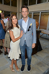 DUNCAN & ZOE STIRLING at a party to celebrate the launch of Le Jardin de Monsieur Li by Hermes in association with Mr Fogg's was held at Hermes, 155 New Bond Street, London on 9th July 2015.