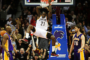 Feb. 16, 2011; Cleveland, OH, USA; Cleveland Cavaliers power forward J.J. Hickson (21) dunks over Los Angeles Lakers power forward Pau Gasol (16) during the fourth quarter at Quicken Loans Arena. The Cavaliers beat the Lakers 104-99. Mandatory Credit: Jason Miller-US PRESSWIRE