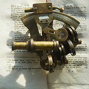 Sextant resting on an open antique book<br />