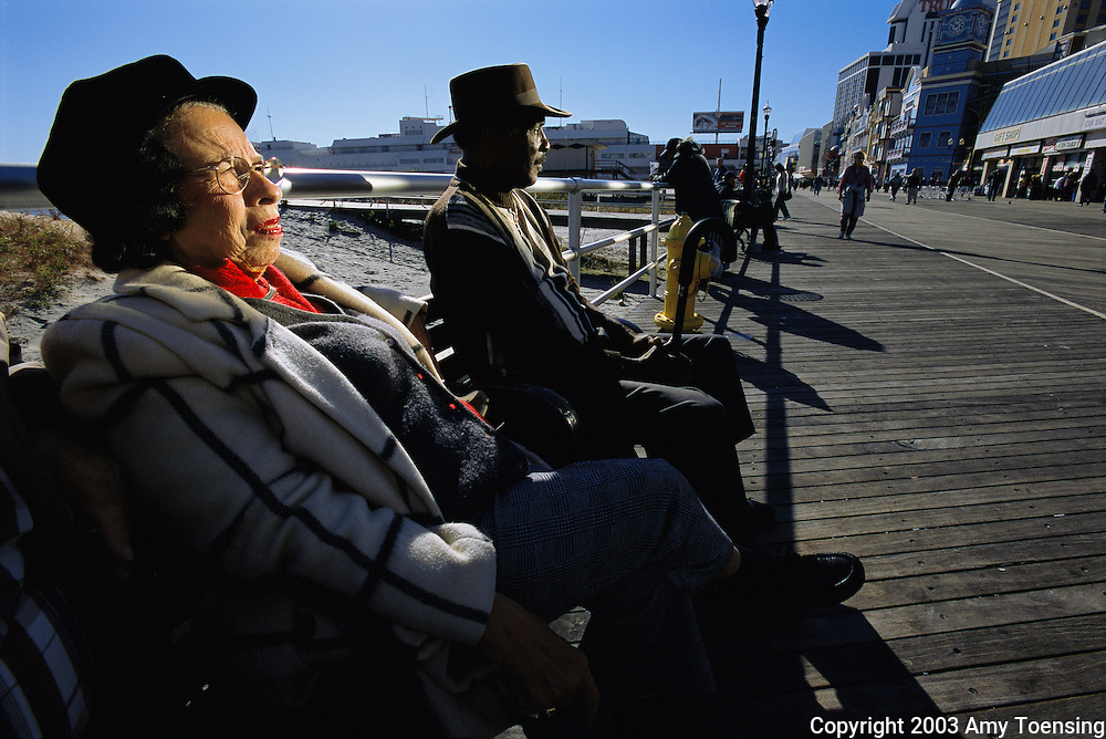 ATLANTIC CITY, NJ - OCTOBER 29: Vera Green (left) and John Toulson (right) take a break from casino gambling and slot machines October 29, 2003 on the Atlantic City Boardwalk in Atlantic City, New Jersey. The Jersey Shore, a 127 mile stretch of coastline known for its variety of beaches, boardwalks, small towns, natural beauty and summer crowds, has been a popular summer destination for over a century. (Photo By Amy Toensing)