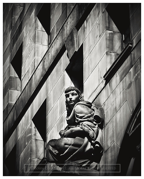 Black and white photograph of statue on building in St Vincent Street, Glasgow.<br /> Mounted print available to purchase.