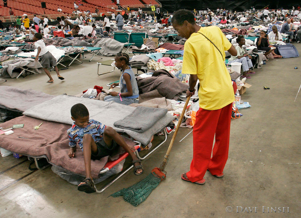 HOUSTON - SEPTEMBER 4:  An evacuee mops the floor of the Reliant Astrodome, Sunday, Sept. 4, 2005. There are currently about 16000 evacuees staying in the shelter. .<br />