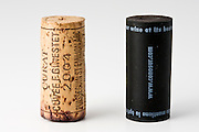 Traditional cork and modern plastic wine stopper