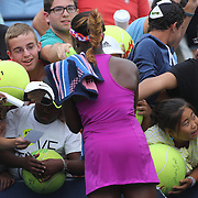 Young fans clammer for autographs from Sloane Stephens, USA, after her third set tie break victory over Mandy Minella, Luxembourg, during the Women's Singles at the US Open. Flushing. New York, USA. 25th August 2013. Photo Tim Clayton