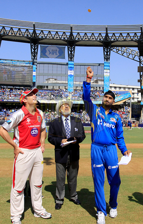 Mumbai Indian captain Harbhajan Singh and Kings XI Punjab player David Hussey during the toss for the match 28 of the Indian Premier League ( IPL) 2012  between The Mumbai Indians and the Kings X1 Punjab held at the Wankhede Stadium in Mumbai on the 22nd April 2012..Photo by: Vipin Pawar/IPL/SPORTZPICS