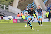 Sheffield Wednesday midfielder Ross Wallace (33)  free kick which is saved  during the Sky Bet Championship match between Huddersfield Town and Sheffield Wednesday at the John Smiths Stadium, Huddersfield, England on 2 April 2016. Photo by Simon Davies.