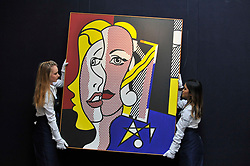 """© Licensed to London News Pictures. 06/10/2017. London, UK. Technicians present """"Female Head"""", 1977, by Roy Lichtenstein at a preview at Sotheby's in New Bond Street of contemporary, impressionist and modern art works to be auctioned in New York in November 2017 Photo credit : Stephen Chung/LNP"""