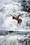 """Climber Katie Cavicchio uses a """"tyrolean traverse"""" technique to cross Utah's Provo River on a rope."""