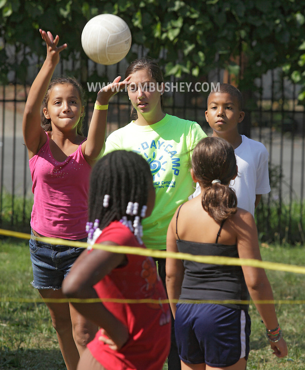 Middletown, New York - A girl serves the ball during a volleyball during a game at the Middletown YMCA summer camp on August 20, 2010.