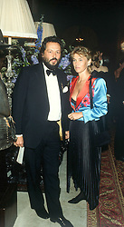 The EARL OF STOCKTON and LADY (MIRANDA) NUTTALL at  dinner in London in June 1990.