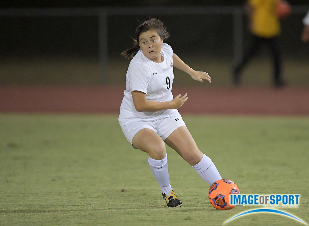 Cal State Dominguez Hills forward Clarissa Chavez (9) dribbles the ball during a nonconference women's soccer match against the Concordia Eagles in Carson, Calif. on Friday, September 8, 2017. Concordia defeated CSUDH 3-1.