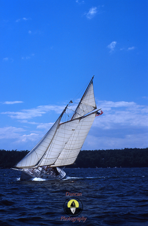 Gaff rigged schooner Dorothy Elizabeth owned by Roger F. Duncan beats to windward in Linekin Bay, Maine. .Photo by Roger S. Duncan.  ...