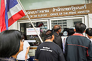 26 NOVEMBER 2013 - BANGKOK, THAILAND: Anti-government protestors try to get into the Bureau of the Budget office in the Ministry of Finance complex. The Budget Bureau is the budgetting office of the Prime Minister. Protestors opposed to the government of Thai Prime Minister Yingluck Shinawatra spread out through Bangkok this week. Protestors have taken over the Ministry of Finance, Ministry of Sports and Tourism, Ministry of the Interior and other smaller ministries. The protestors are demanding the Prime Minister resign, the Prime Minister said she will not step down. This is the worst political turmoil in Thailand since 2010 when 90 civilians were killed in an army crackdown against Red Shirt protestors. The Pheu Thai party, supported by the Red Shirts, won the 2011 election and now govern. The protestors demanding the Prime Minister step down are related to the Yellow Shirt protestors that closed airports in Thailand in 2008.     PHOTO BY JACK KURTZ