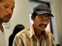 NEW ORLEANS, LA- June 22:  (L-R) Trung Le and Dung Nguyen are told that only 20 individuals will receive assistance per day... Vietnamese affected by the Gulf oil spill because of their work in the fishing industry, wait on an early morning line at Mary Queen of Vietnam Catholic Church to receive financial assistance from Catholic Community Services, in New Orleans, Louisiana, Tuesday June 22, 2010.  (Melina Mara/The Washington Post)