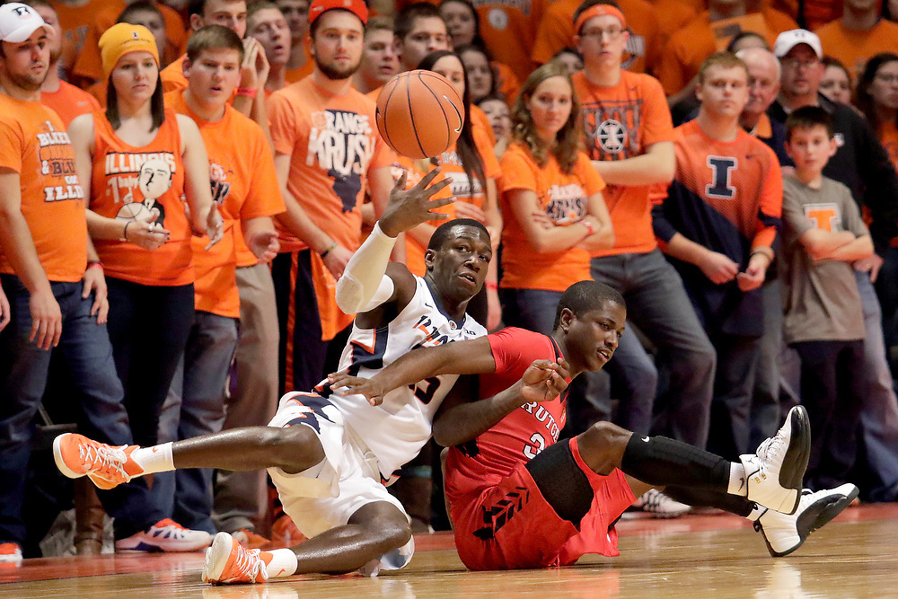 Illinois guard Kendrick Nunn (25) dives for a loose ball against Rutgers guard Khalil Batie (33) during the second half of an NCAA college basketball game at the State Farm Center Tuesday, Feb. 3, 2015, on the University of Illinois campus in Champaign, Ill. Illinois won the game 66-54. (For the Herald & Review/ Stephen Haas)