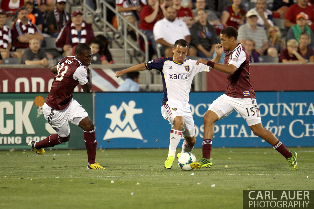 August 3rd, 2013 - Real Salt Lake midfielder Luis Gil (21) pushes the ball through Colorado Rapids defender Chris Klute (15) and defender German Mera (33) in first half action of the Major League Soccer match between Real Salt Lake and the Colorado Rapids at Dick's Sporting Goods Park in Commerce City, CO