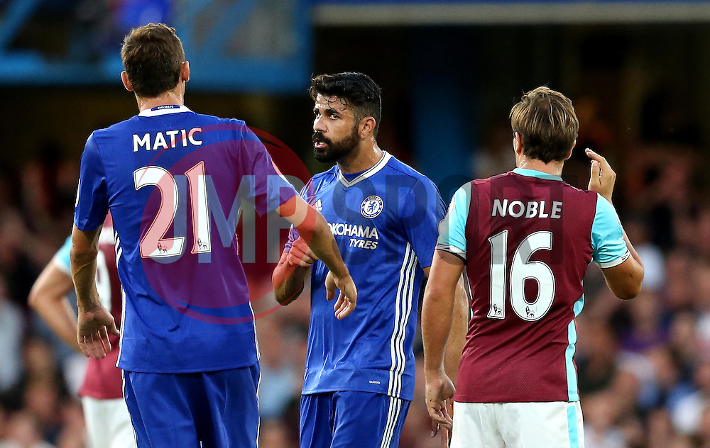 Diego Costa of Chelsea looks angrily at teammate Nemanja Matic after receiving a yellow card for arguing with the referee - Mandatory by-line: Robbie Stephenson/JMP - 15/08/2016 - FOOTBALL - Stamford Bridge - London, England - Chelsea v West Ham United - Premier League