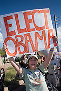 Sept. 10, 2008 -- PHOENIX, AZ: People wave Barack Obama campaign signs during a rally at the new Obama campaign office in Phoenix Wednesday. The Barack Obama presidential campaign opened an office in Phoenix Wednesday just five miles from the home of Republican presidential candidate John McCain. About 400 Obama supporters came the opening.   Photo by Jack Kurtz