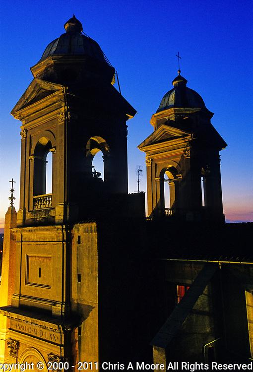 Triniti dei Monti lighted at dusk.  Taken from Hotel Hassler at Piazza della Trinità dei Monti, 600187 Rome, Italy