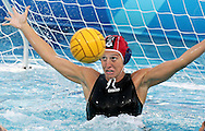 Italian goalkeeper Georgia Ellinaki defend a shot on goal by Greece during the gold medal match between Greece and Italy in the Women's Water Polo final at the Olympic Aquatic Centre in Athens Thursday 26 August 2004.  Italy won the gold medal in a close 10-9 match. (Photo by Patrick B. Kraemer / MAGICPBK)