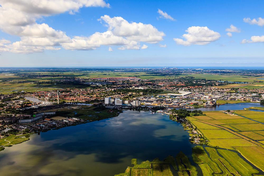 Nederland, Noord-Holland, Zaanstad, 14-06-2012; rivier de Zaan gezien vanuit Polder Wormer. Links Wormer, midden en rechts Westzaan en West-Knollendam. Op het tweede plan Krommenie en Assendelft..The river Zaan in Zaanstad and the Polder Wormer..luchtfoto (toeslag), aerial photo (additional fee required).foto/photo Siebe Swart