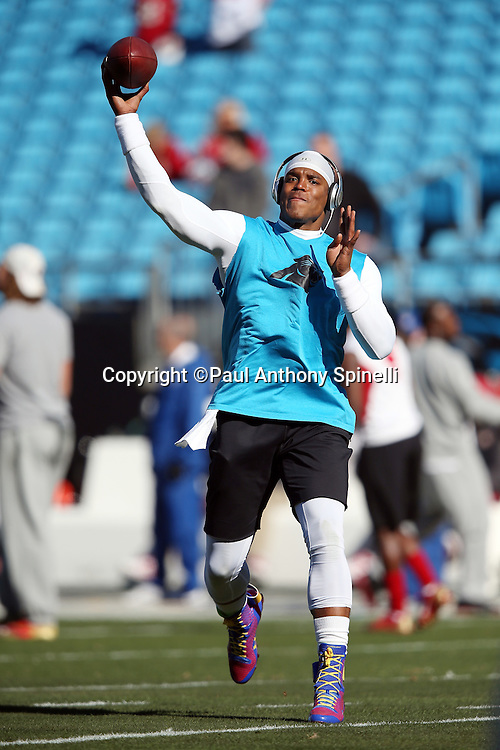Carolina Panthers quarterback Cam Newton (1) throws a pregame pass while warming up before the NFC Divisional Playoff NFL football game against the San Francisco 49ers on Sunday, Jan. 12, 2014 in Charlotte, N.C. ©Paul Anthony Spinelli