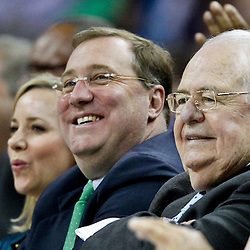 April 15, 2012; New Orleans, LA, USA; New Orleans Hornets newly named owner Tom Benson and  New Orleans Saints, Executive Vice President/Chief Financial Officer Dennis Lauscha watch courtside during the second half of a game at the New Orleans Arena. The Hornets defeated the Grizzlies 88-75.  Mandatory Credit: Derick E. Hingle-US PRESSWIRE