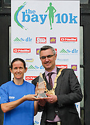 No fee for Repro:.Barbara Cleary lady's winner at the DLR Bay 10K road race in a time of 35 minutes and 52 seconds pictured been presented with her winning prize by An Cathaoirleach Cllr Tom Joyce, Dun Laoghaire-Rathdown County Council. Pic Jason Clarke Photography