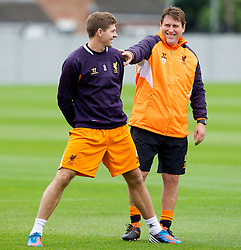 LIVERPOOL, ENGLAND - Wednesday, October 24, 2012: Liverpool's captain Steven Gerrard MBE and assistant manager Colin Pascoe during a training session at Melwood Training Ground ahead of the UEFA Europa League Group A match against FC Anji Makhachkala. (Pic by Vegard Grott/Propaganda)
