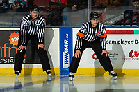 KELOWNA, BC - NOVEMBER 6:  Referee Mark Pearce stands on the ice with line official Jade Portwood at the Kelowna Rockets against the Victoria Royals at Prospera Place on November 6, 2019 in Kelowna, Canada. (Photo by Marissa Baecker/Shoot the Breeze)