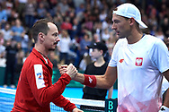 Sopot, Poland - 2018 April 08: (L) Radoslaw Szymanik - captain national team congrats to Lukasz Kubot from Poland while Men's Double Match Nr 3 during Poland v Zimbabwe Tie Group 2, Europe/Africa Second Round of Davis Cup by BNP Paribas at 100 years of Sopot Hall on April 08, 2018 in Sopot, Poland.<br /> <br /> Mandatory credit:<br /> Photo by © Adam Nurkiewicz / Mediasport<br /> <br /> Adam Nurkiewicz declares that he has no rights to the image of people at the photographs of his authorship.<br /> <br /> Picture also available in RAW (NEF) or TIFF format on special request.<br /> <br /> Any editorial, commercial or promotional use requires written permission from the author of image.