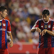 Claudio Pizarro, (right),  FC Bayern Munich, discusses positioning with Robert Lewandowski, FC Bayern Munich, during the FC Bayern Munich vs Chivas Guadalajara, Audi Football Summit match at Red Bull Arena, New Jersey, USA. 31st July 2014. Photo Tim Clayton