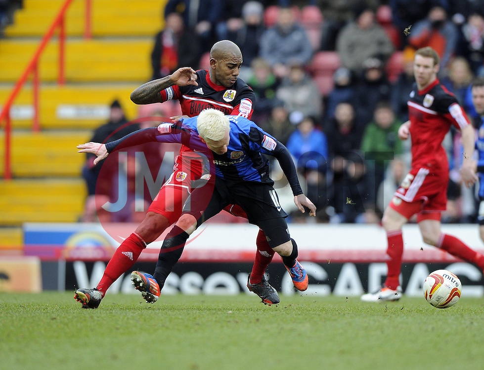 Bristol City's Marvin Elliott battles for the ball with Barnsley's David Perkins - Photo mandatory by-line: Joe Meredith/JMP - Tel: Mobile: 07966 386802 23/02/2013 - SPORT - FOOTBALL - Ashton Gate - Bristol -  Bristol City V Barnsley - Npower Championship