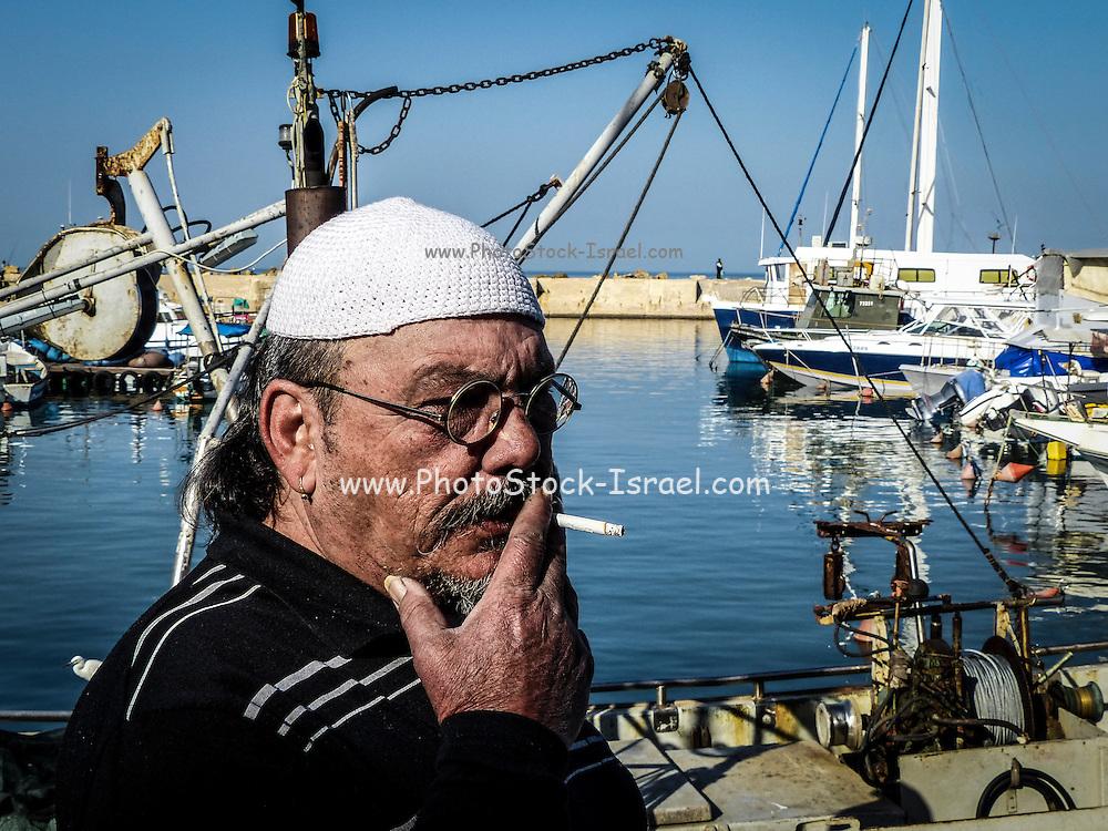 Israel, Jaffa, The ancient port now fishing port A local fisherman